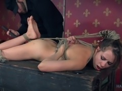 Rope bondage is a sexy treat for this beautiful brunette