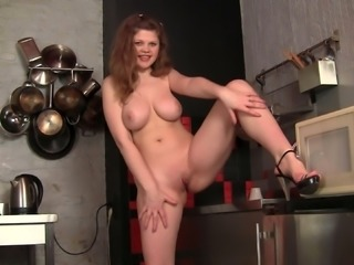 Plump brunette sweetie with big boobies masturbates at kitchen