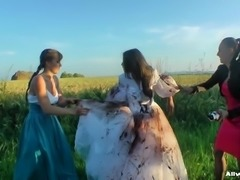 Girls cover the pretty bride in dirty mud and strip her