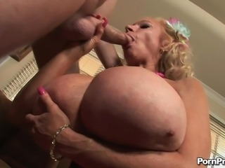 Mature blonde with large melons screaming as a big cock ravishes her cunt