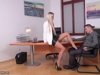 Stunning blonde fucks a couple of handsome men on a desk