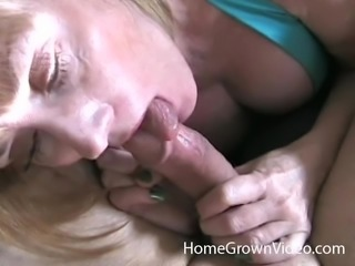 Cougar gives head to a long throbbing boner and makes it cum