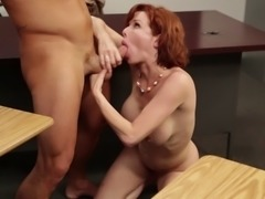 Redhead called Veronica is about to get nailed by the blackboard