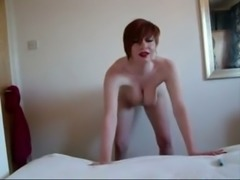 Busty redhead MILF fingering wet vagina in amateur video