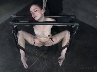 Slim redhead slag Ivy Addams likes being bound in the dungeon