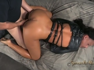 Dirty and wicked brunette milf in straightjacket banged on the bed