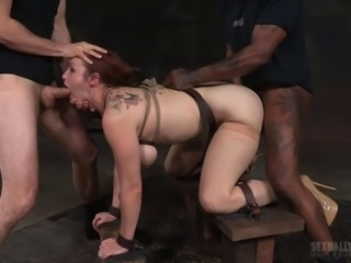 Raunchy redhead babe gets tied up and pleasures two massive boners