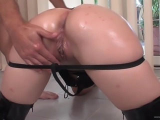 Lewd blonde Lily, wearing a corset, gets her pussy fingered and fucked