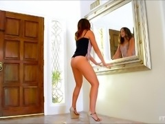 Redhead solo model with shaved pussy stripteasing lovely