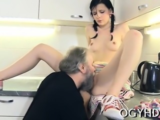 Slutty old fart stuffs mouth of a young chick with his knob