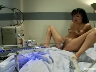 Kinky Annie Cruz gets toyed by a machine in a hospital