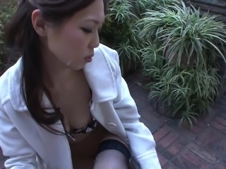 Japanese maiden with natural tits giving dick blowjob outdoor