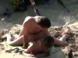Spying on amateur couple having dirty sex on a beach
