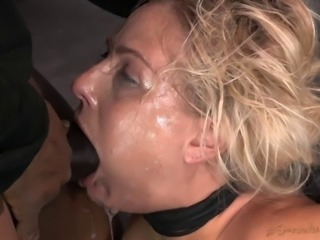Blonde with tits in bondage fucked between her luscious pair of lips
