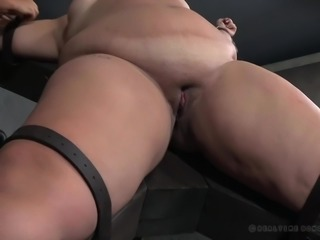Bondage lovers, if you haven't seen Mimosa yet, here is your chance. If you have and are a fan, welcome back. She's strapped to the big X, secured by some helpers, before her executor comes out with the vibrator. Watch her wiggle, watch her squirm, watch her cum and her makeup run.