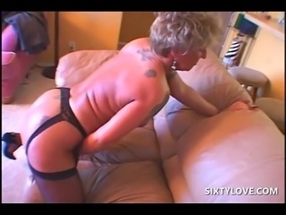 Pierced tattooed mature masturbating cunt