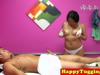 Busty asian masseuse tugging client for tip