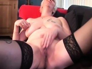 Slutty mature in stockings rubbing herself