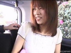 Asian cowgirl pleasured with nice toy in the car close up shoot