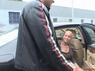 Taking a stranger for a ride outside of town in her car