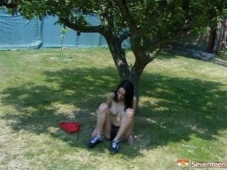 Lace panties teen sits under a tree and plays with her pussy
