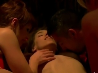 Young couple enjoying their first swinger party