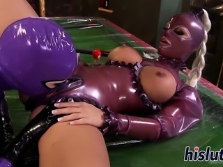 Two busty latex-clad babes fuck each other