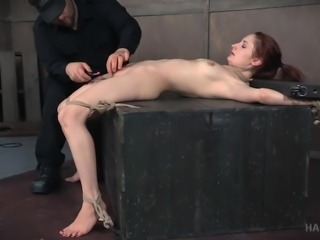 I can only sympathize with this redhead cutie Violet Monroe. Tightly bound in hard ropes, absolutely naked, gagged and helpless, she lies on the cold floor, not knowing what to wait for. Then comes the executor and gives her hairy pussy some extreme pleasures... Join us to learn more!