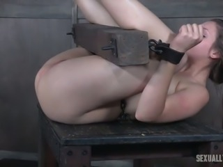 Porn model Nora Riley is fucked and punished in the dungeon
