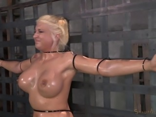 Oiled bondage babe getting deepthroat punishment in BDSM