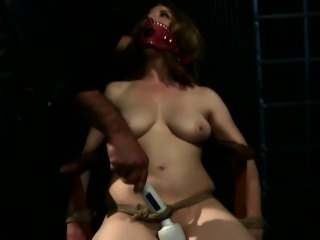 Restrained slave gagging on doms cock