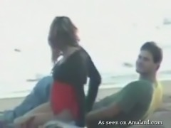 Horny Spanish couple having quick sex on the public beach