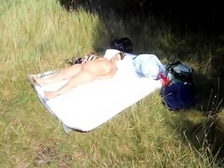 An unchaste french woman sleeps totally naked in the sun