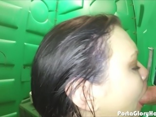 Grocery store slut swallows cum in the parking lot in a Porta Potty Gloryhole