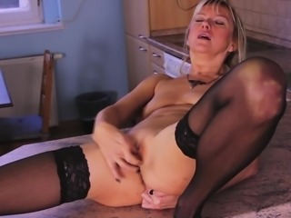 Foxy mature bombshell strips down and play around with her pussy
