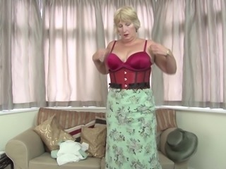 Classy grandmother strips down and rams her pussy with a toy