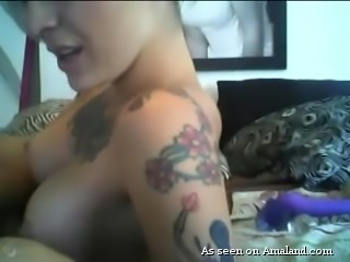 Alt girls always like to try new things sexually. This hottie starts off by sticking her dildo up her asshole, and that brings her so close to orgasm. That's not enough for her. She wants to get off by stimulating her vagina, too. So, she sticks a dildo in her twat as well.