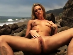 Mesmerizing girl called Dahlia showing her sexy body at the beach
