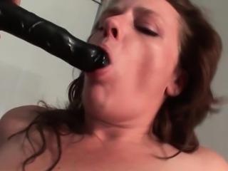Kinky mature sucks and rides huge dildo