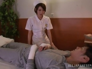 Hot nurse from Japan jerks off a patient and rides his dick