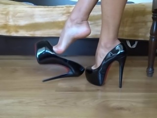 Dangling my black shiny high heels ad shoeplay