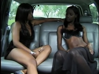 Two attractive black chicks going totally lesbian on the back seat