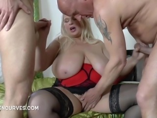 Buxom Blonde does two cocks before breakfast