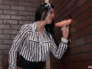 Filthy bitch sucking huge sex toy through the gloryhole