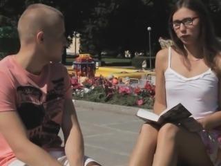 Young sweetheart in glasses satisfies her secret desires
