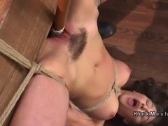 Tied up to wooden beam upside down brunette fucked