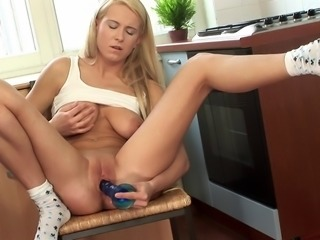 Sexy Wanda spreads her legs for a stiff blue pleasure toy