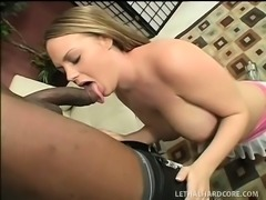 Busty blonde gets on top of a huge black cock and rides it with desire