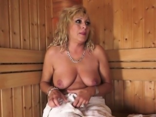 Busty babe pussylicking a mature lesbian