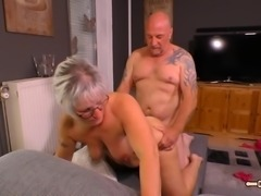 Woman with gray hair bends over for a lover's fat cock